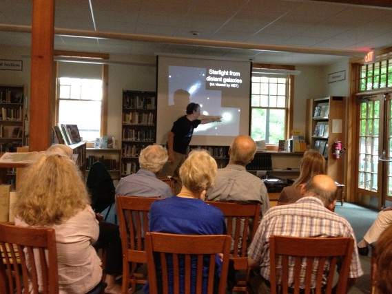 "Community members attend a talk titled ""Why is it dark at night?"" at the Putney Public Library with Tom Geballe"